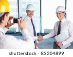 A man photographed handshake business partners in construction - stock photo