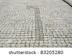 cobbled road with arrow to left - stock photo
