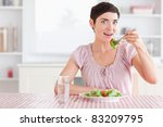 charming  woman eating salad in ... | Shutterstock . vector #83209795