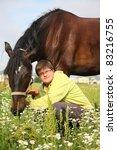 teenager boy hugging brown horse | Shutterstock . vector #83216755