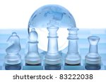 Glass chess pieces, board and globe concept for global business - stock photo