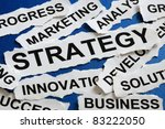Torn newspaper headlines depicting business strategy - stock photo