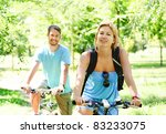Young man and woman having a bike ride in nature - stock photo