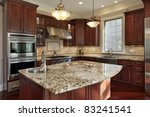 Stock photo kitchen with granite island and cherry wood cabinetry 83241541