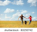 young happy couple running on a ... | Shutterstock . vector #83250742