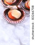 Small photo of Raw queen scallops (lat. Aequipecten opercularis) on ice (Selective Focus, Focus the front of the scallop's meat)