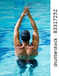Male swimmer stretching  at the swimming pool - stock photo