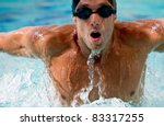 Professional man swimming with hat and goggles at the pool - stock photo