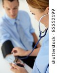 doctor taking young man's blood ... | Shutterstock . vector #83352199