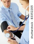 doctor taking young man's blood ... | Shutterstock . vector #83352205