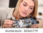 woman repairing pc | Shutterstock . vector #83361775