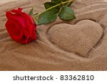 Red Rose On The Beach With A...