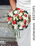bride with bouquet of roses | Shutterstock . vector #83372491
