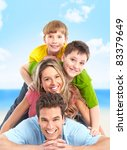happy smiling family on the... | Shutterstock . vector #83379649
