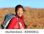 Healthy lifestyle woman hiker smiling happy outside on hiking trip. Beautiful natural candid smile on mixed race Caucasian / Asian female hiker outdoors in nature. - stock photo