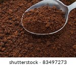 Spoon of coffee at coffee background - stock photo
