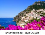 Panoramic view of Positano on the Amalfi Coast of Italy with beautiful flowers in the foreground - stock photo