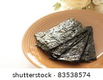 Korean seasoned dried laver on plate - stock photo