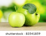 Two Ripe Apples On Table...