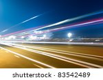 light trails on the gate of heavenly peace at night in beijing - stock photo