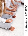 Yoga lotus position detail of kids and adult - relaxation concept - stock photo