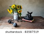 Still Life with Sunflowers and antique black Telephone - stock photo