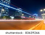 modern city at night with street traffic in beijing,China - stock photo