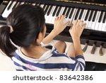 Practice Piano  Asian Teenage...