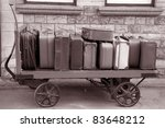 Old Suitcases on Transport Trolly at Railway Station - stock photo