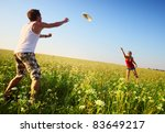 young couple playing frisbee on ... | Shutterstock . vector #83649217