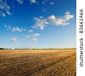 black ploughed field under blue ... | Shutterstock . vector #83661466