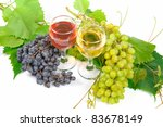 Arrangement of grapes and a glass of wine - stock photo