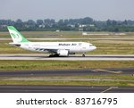 DUSSELDORF, GERMANY - MAY 21: An A310 lands on May, 21 2011 in the airport, Dusseldorf, Germany. Mahan Air as the largest carrier in Iran country increased flights from its hub in Tehran to Dusseldorf. - stock photo