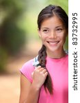 Healthy outdoors woman hiking. Young mixed Chinese / Caucasian female hiker smiling happy outdoors during hiking trip in forest. - stock photo