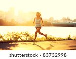 female runner running at sunset ... | Shutterstock . vector #83732998