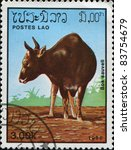Small photo of LAOS - CIRCA 1985: A stamp printed in Laos shows Kouprey, also known as Kouproh or Grey ox - Bos sauveli, circa 1985