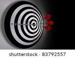 Darts hitting a target on black background - stock photo
