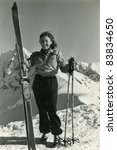 Vintage photo of young female skier (forties) - stock photo