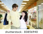young family with shopping bags ... | Shutterstock . vector #83856940