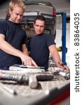 two mechanics looking at work... | Shutterstock . vector #83864035