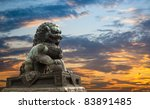majestic lion statue with sunset glow - stock photo