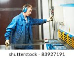 worker at workshop operating...   Shutterstock . vector #83927191
