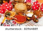 Maslenitsa festival meal - pancake with caviar and tea - stock photo