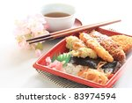 Japanese Packed lunch with hot tea with cherry blossom - stock photo