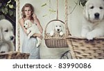 Pretty girl with puppies - stock photo