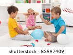 Kids popping balloons in their room fearing the blast - focus on the right side boy - stock photo