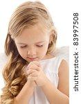 Beautiful little girl praying - closeup, isolated - stock photo