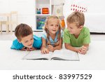 Kids practice reading and story telling in their room - stock photo