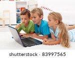 Kids found something interesting on laptop computer studying it - stock photo