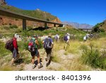 Three Female Hikers Follow The...